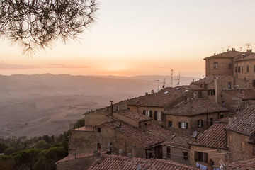 medieval Volterra, house roofs and sun, Tuscany