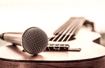 Microphone on acoustic guitar in vintage color tone