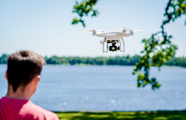 Quadrocopter with video camera flying outdoors