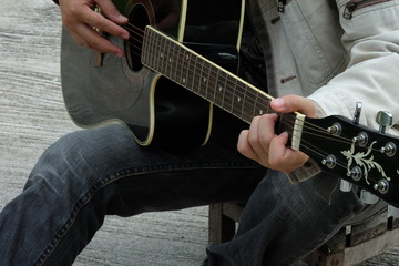 Close-up of musician playing guitar, selective focus