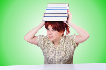 Girl student with books on white