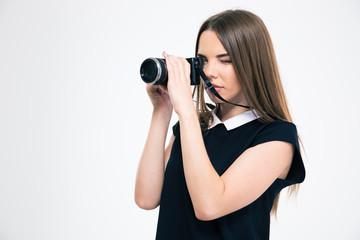 Beautiful woman making photo on camera