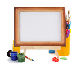 paint supplies and frame isolated on white