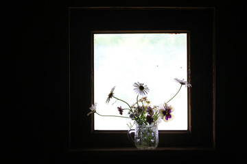 Stylized blurred photo of a bouquet flowers on the window