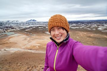 Tourist selfie with landscape background