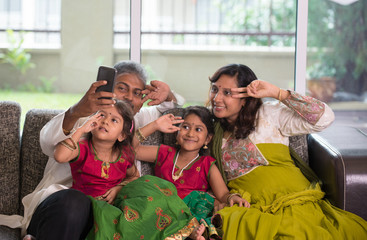 Asian Indian family selfie or self photograph at home. Parents a