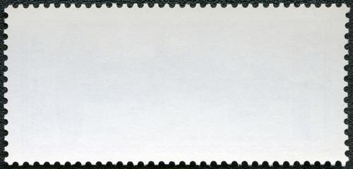 Blank postage stamp on a black background