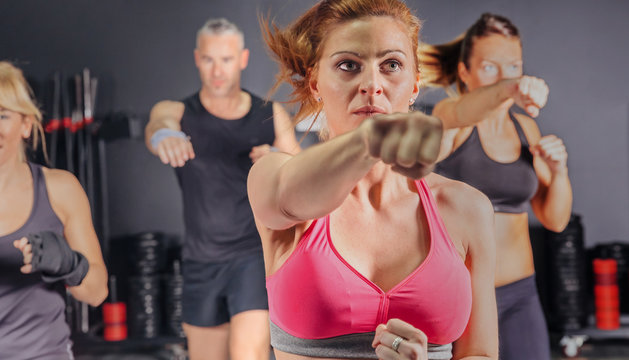 People in a boxing class training punch