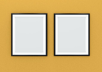 Two black picture frames over orange wall