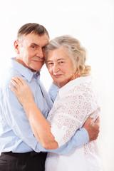 portrait of smiling elderly couple