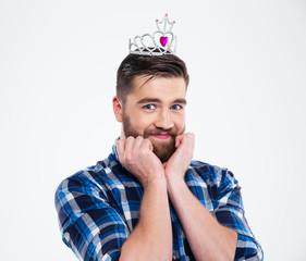 Portrait of a happy feminine man in queen crown