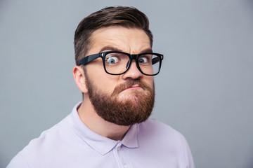 Funny hipster man looking at camera