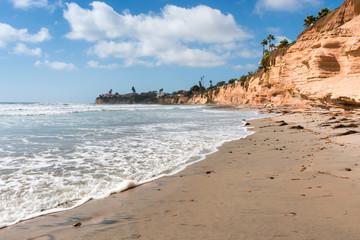 Summer beach. Impressive surf the waves on the coast of California, San Diego. Red rocks.