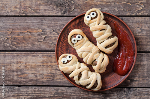 Mummy sausages scary halloween party food decoration wrapped in
