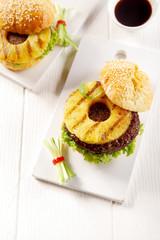 Two Tasty Hawaiian Burgers on White Plate