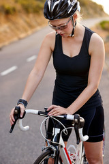 female cyclist checking time