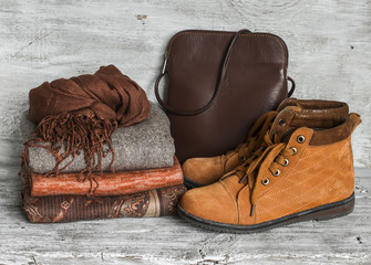 Women's clothing and accessories - skirt, turtleneck, scarf, shoes, bag, bright wooden surface