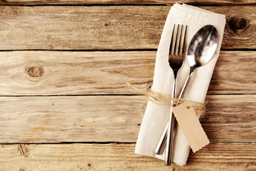 Spoon and Fork Tied on White Napkin with Tag