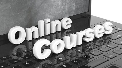 Online Courses 3D text on laptop keyboard, with blackboard on screen.