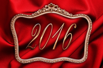 Golden 2016 in a antique frame with red silk background