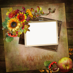 Frame with autumn leaves and flowers on vintage background