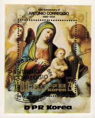 "DPR KOREA - CIRCA 1983: mail stamp printed in DPR Korea featuring 450 years since the death of Antonio Correggio, a reproduction of his painting ""Madonna with child and angels"", circa 1983"