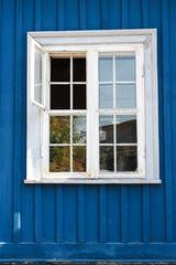 White window in a blue wall