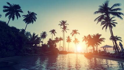 Asian tropical beach during an surrealistic sunset.