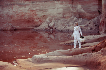 Water on Mars, futuristic astronaut without a helmet in another