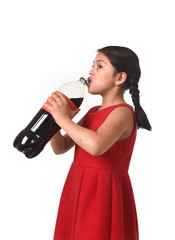 happy female child holding big soda cola bottle drinking in sugar drink abuse