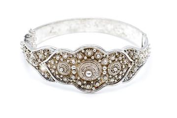 Dutch ornamented (zeeuwse knoop) silver slave bangle bracelet against a white background