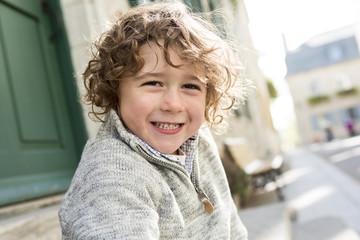 portrait of a boy on a urban background