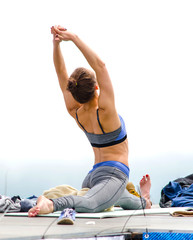 young woman makes yoga