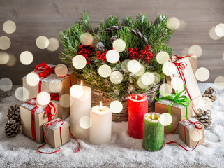 Christmas still life with burning candles gift box lights