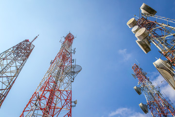 cellular communication towers on blue sky