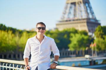 Handsome Parisian man near the Eiffel tower