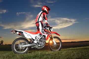 Motocross Byker Riding During Sunset