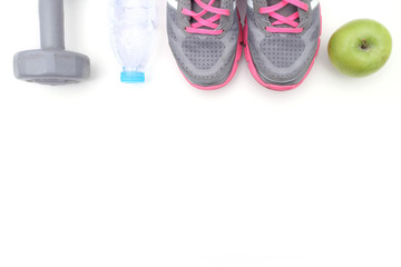 Sport shoes and water with set for sports activities on white with copy space