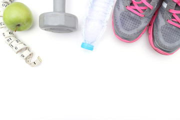 Wall Mural - Sport shoes and water with set for sports activities on white with copy space