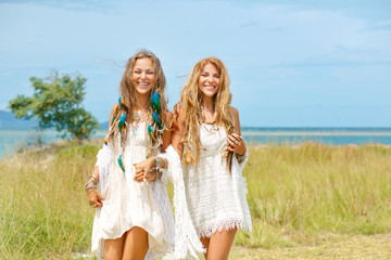 two happy hippie girls