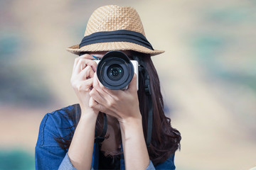 woman traveler wearing blue dress as photographer, take photo wi