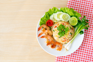 Top view ; Shrimp fried rice on wooden background