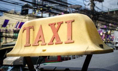 Old taxi sign on roof top car. Bangkok, Thailand