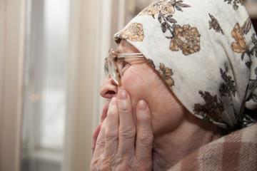elderly woman   near window