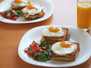 Croque madame (baked or fried boiled ham and cheese sandwich with topped with fried egg).
