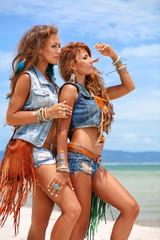 beautiful hippie girls in denim clothes on the beach