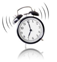 alarm clock ringing on white background