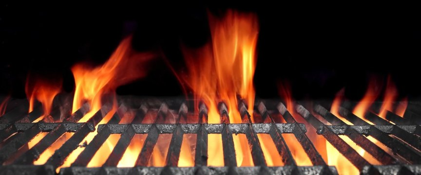 Hot Flaming BBQ Grill With Bright Flames And Glowing Coals