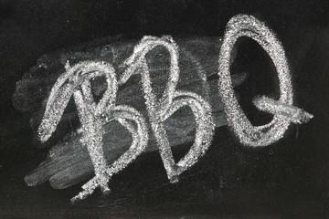 BBQ Sign On The Black Chalkboard Closeup