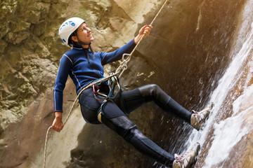 Female hiker climbing